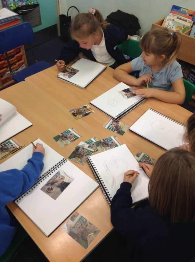 Class busy drawing owls